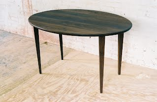 eliptical walnut table